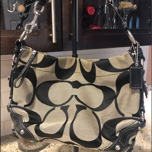 Coach black and tan fabric/leather bag